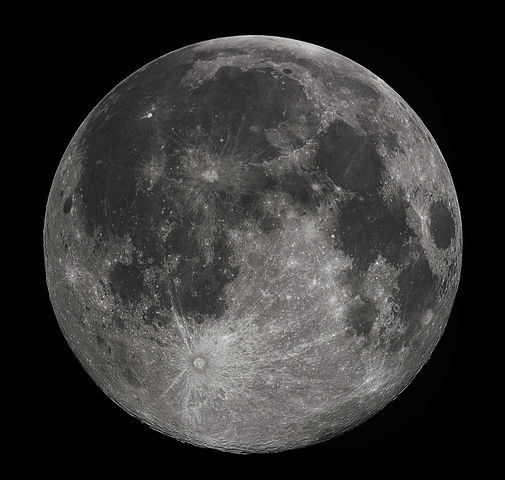 Full moon as seen from space with dark sky in background.